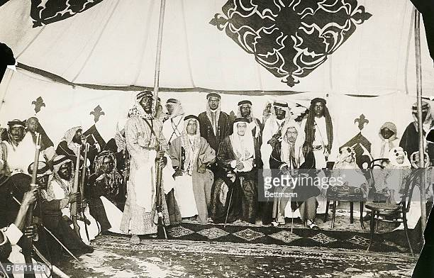 Emir Faisal later King son of King Ibn Sa'ud of Arabia and leader of his father's armies holds an audience with his warriors in his tent