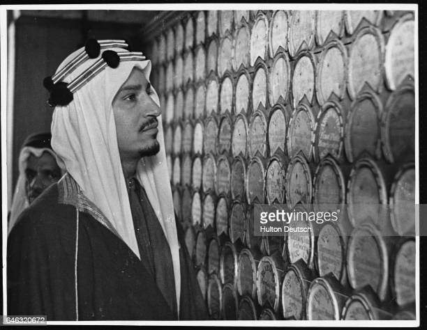Emir Khalid Feisal fourth son of King Ibn Saud of Saudi Arabia looks over the Royal Stables in 1943