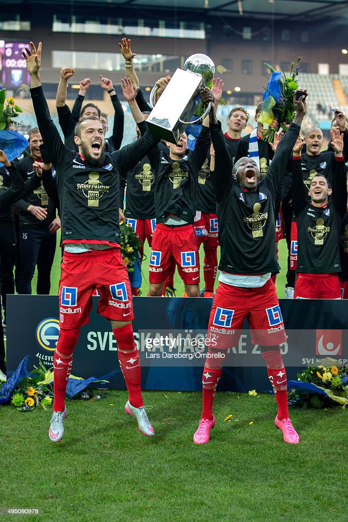 Emir Kujovic and Alhaji Kamara of Norrkoping celebrate with team mates after wining the Swedish League title following the match between Malmo FF and IFK Norrkoping at Swedbank Stadion on October 31, 2015 in Malmo, Sweden.