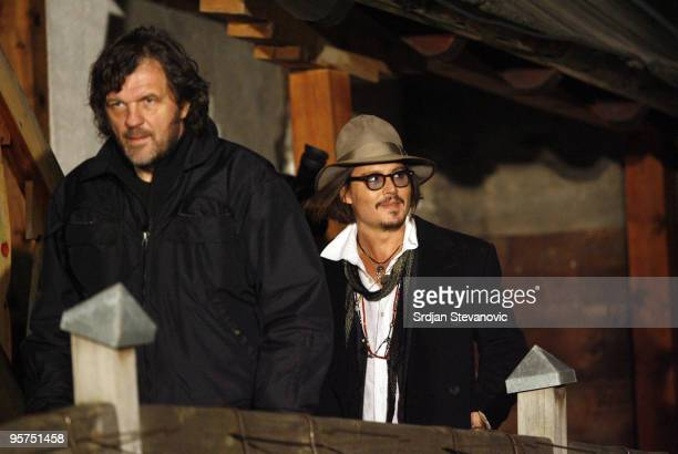 Emir Kusturica and Johnny Depp arrive at opening ceremony during the Kustendorf film festival on January 13 2010 in Belgrade Serbia