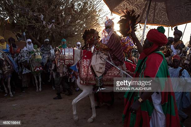 Emir Muhammad Sanusi II passes in front of his palace February 8 in Kano during a Durbar ceremony in honor of his coronation Sanusi a former Nigeria...