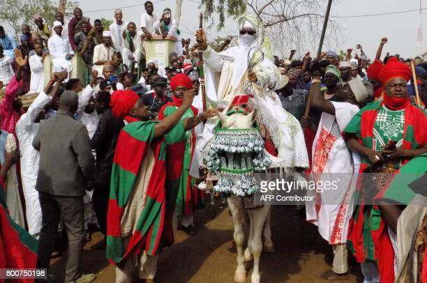 Emir of Kano Muhammadu Sanusi II departs on horseback from the Eid prayer ground in Kano on June 25 after prayers to mark the end of the holy month...