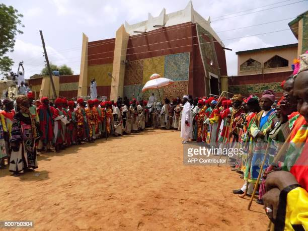 Emir of Kano Muhammadu Sanusi II sits on horseback outside his palace in Kano on June 25 as he prepares to receive greetings after prayers to mark...