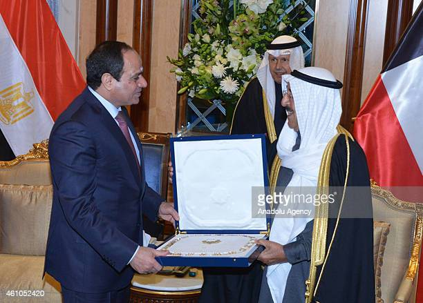 Emir of Kuwait Sabah AlAhmad AlJaber AlSabah presents a gift to Egyptian President Abdel Fattah elSisi during a meeting within Sisi's official Kuwait...