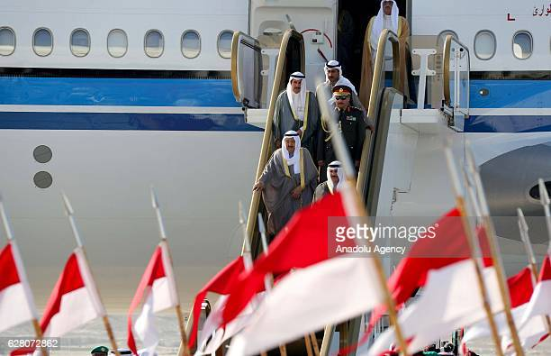 Emir of Kuwait Sheikh Sabah IV Ahmad AlJaber AlSabah steps out of a plane upon his arrival at Sakhir Air Base in Manama Bahrain on December 6 2016...