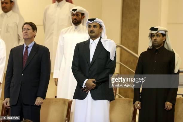 Emir of Qatar Sheikh Tamim bin Hamad Al Thani Andrew Swiger Senior Vice President and Principal Financial Officer of Exxon Mobil and Nasser...