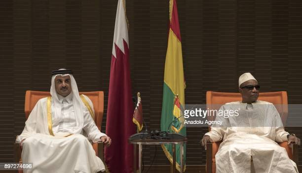 Emir of Qatar Sheikh Tamim bin Hamad Al Thani attends a meeting with President of Guinea Alpha Conde in Conakry Guinea on December 22 2017