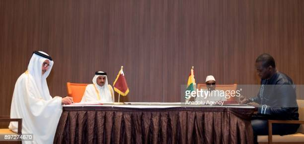 Emir of Qatar Sheikh Tamim bin Hamad Al Thani attends a protocol signing ceremony with President of Guinea Alpha Conde in Conakry Guinea on December...