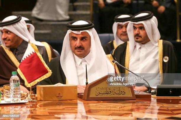 Emir of Qatar Sheikh Tamim bin Hamad Al Thani attends the opening ceremony of the 38th Gulf Cooperation Council leaders summit in Kuwait City Kuwait...