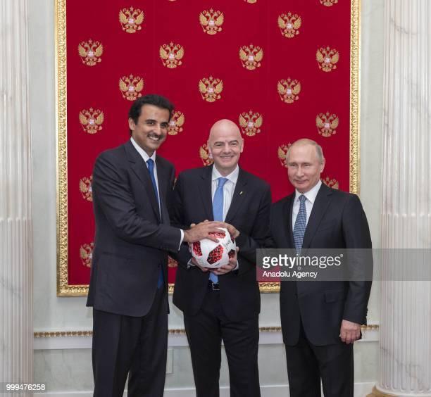 Emir of Qatar Sheikh Tamim bin Hamad Al Thani , FIFA President Gianni Infantino and Russian President Vladimir Putin attend the handover ceremony for...