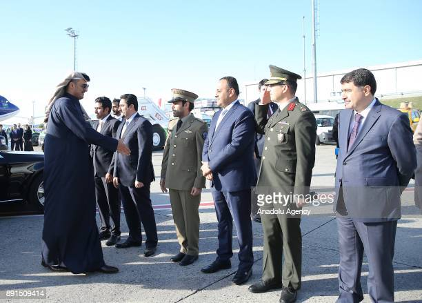 Emir of Qatar Sheikh Tamim bin Hamad Al Thani shakes hands as he is flanked by Governor of Istanbul Vasip Sahin before his departure after attending...