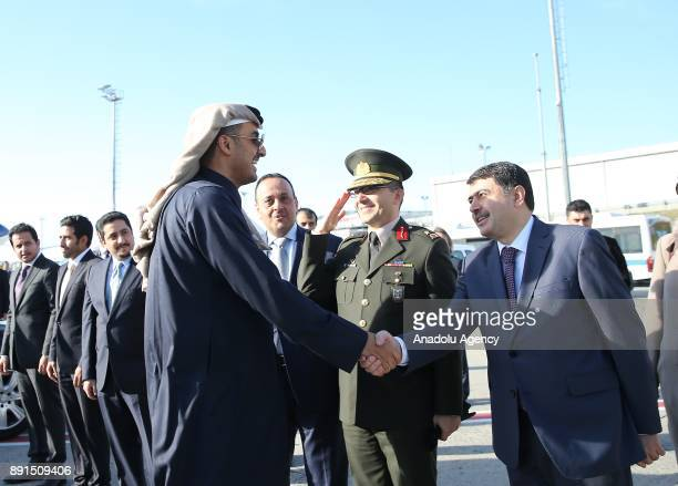 Emir of Qatar Sheikh Tamim bin Hamad Al Thani shakes hands with Governor of Istanbul Vasip Sahin before his departure after attending the...