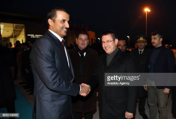 Emir of Qatar Sheikh Tamim bin Hamad Al Thani shakes hands with Turkish Defense Minister Nurettin Canikli as he prepares to leave Ankara Turkey on...