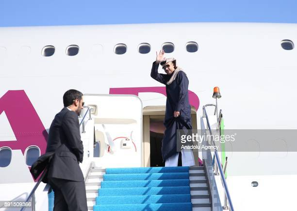 Emir of Qatar Sheikh Tamim bin Hamad Al Thani waves as he leaves the country after attending the extraordinary summit of the Organization of Islamic...