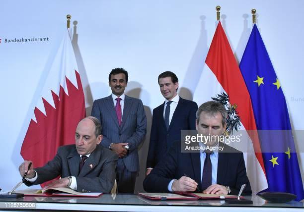 Emir of Qatar Sheikh Tamim bin Hamad alThani and Austrian Chancellor Sebastian Kurz stand behind as Austrian Economy Minister Hartwig Loger and...