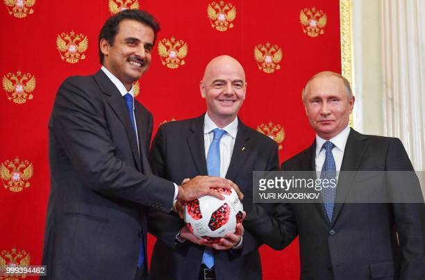 Emir of Qatar Sheikh Tamim bin Hamad AlThani FIFA President Gianni Infantino and Russian President Vladimir Putin pose for a photography during a...