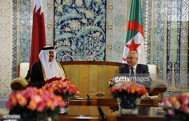 Emir of Qatar Sheikh Tamim bin Hamad AlThani meets with Algerian Speaker of the Council of the Nation Abdelkader Bensalah upon his arrival at...