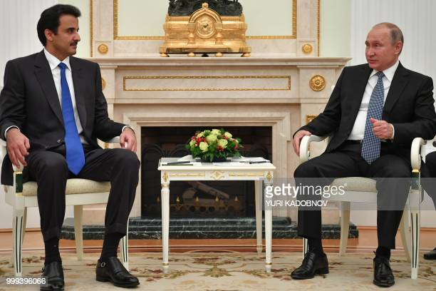 Emir of Qatar Sheikh Tamim bin Hamad AlThani speaks with Russian President Vladimir Putin during their meeting at the Kremlin in Moscow on July 15...