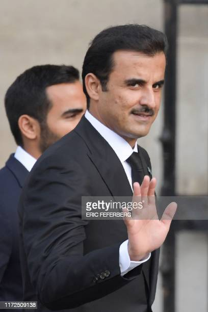 Emir of Qatar Sheikh Tamim bin Hamad al-Thani waves as he arrives to attend a church service for former French President Jacques Chirac at the...