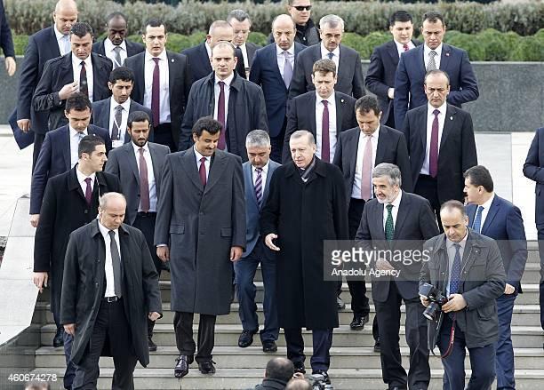 Emir of Qatar Sheikh Tamim bin Hamad bin Khalifa Al Thani and Turkish President Recep Tayyip Erdogan walk together as they leave the Ahmet Hamdi...