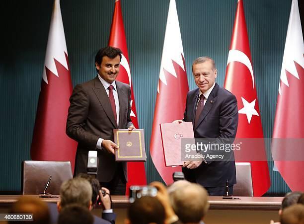 Emir of Qatar Sheikh Tamim bin Hamad bin Khalifa Al Thani and Turkish President Recep Tayyip Erdogan pose after they signed political declaration...