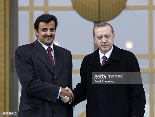 Emir of Qatar Sheikh Tamim bin Hamad bin Khalifa Al Thani is welcomed by Turkish President Recep Tayyip Erdogan prior to a meeting at the...