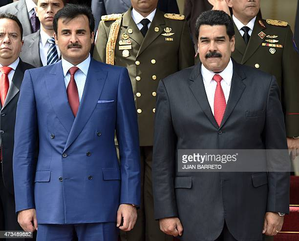 Emir of Qatar Sheikh Tamim bin Hamad bin Khalifa Al Thani receives military honors as he is welcomed by Venezuelan president Nicolas Maduro to...