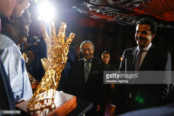 Emir of Qatar Sheikh Tamim Hamad AlThani and Malaysian Prime Minister Tun Dr Mahathir Mohamad attend the Sheikh Tamim Hamad AlThani International...