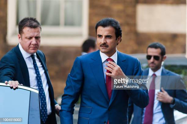 Emir of Qatar Sheikh Tamim ibn Hamad Al Thani arrives at Downing Street in central London for talks with British Prime Minister Theresa May July 24...