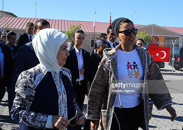 Emir of Qatar Sheikh Tamim's mother Sheikha Mozah and Turkey's First Lady Emine Erdogan walk handtohand during their visit to the Syrian Refugee Camp...