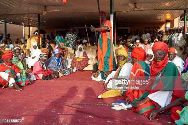 Emir of the city of Gumel with bodyguards and his entourage dressed in full dress sitting to receive the honors of his subjects during the...
