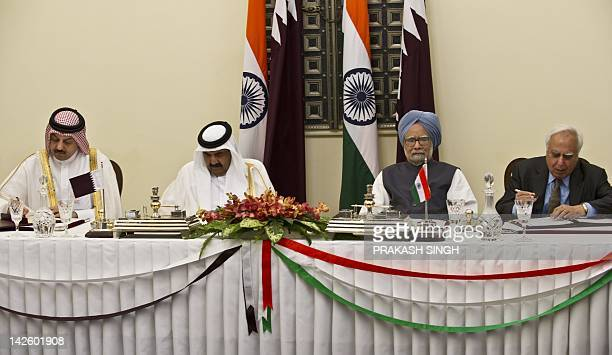 Emir of the State of Qatar Sheikh Hamad Bin Khalifa Al-Thani and Indian Prime Minister Manmohan Singh watch as Indian Human Resource Development...