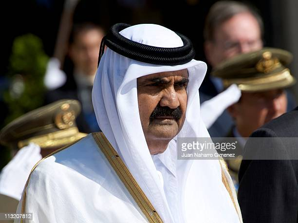 Emir of the State of Qatar Sheikh Hamad Bin Khalifa AlThani bids farewell to King Juan Carlos and Queen Sofia of Spain at El Pardo Palace on April 27...