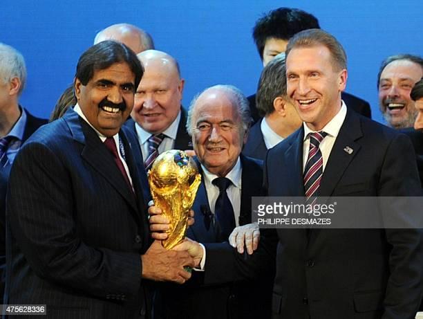 Emir of the State of Qatar Sheikh Hamad bin Khalifa AlThani Fifa President Joseph Blatter and Russia's Deputy Prime Minister Igor Shuvalov pose with...