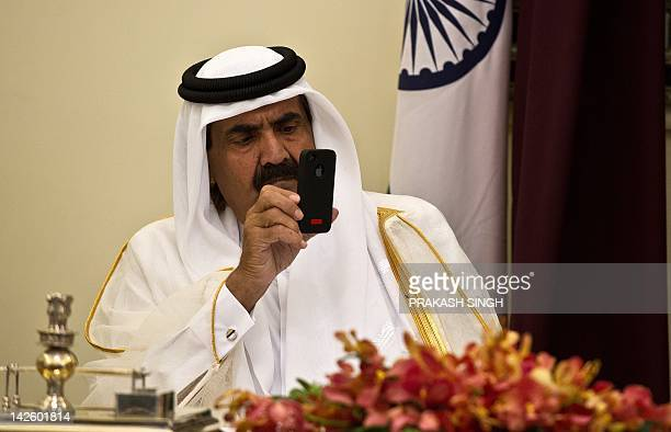 Emir of the State of Qatar Sheikh Hamad Bin Khalifa AlThani takes pictures of Indian Prime Minister Manmohan Singh and delegation with his Iphone...