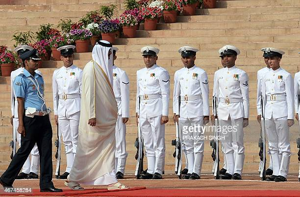 Emir of the State of Qatar Sheikh Tamim Bin Hamad AlThani inspects a guard of honour of Indian troops during a ceremonial reception at The...
