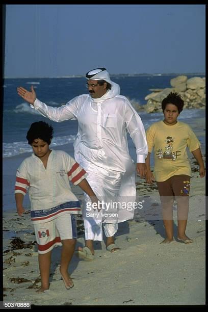 Emir Sheikh Hamad bin Khalifa alThani enjoying leisure time on beach w 2 of his sons