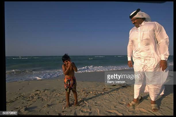 Emir Sheikh Hamad bin Khalifa alThani enjoying leisure time on beach w his 4yrold son Khalifa bin Hamad