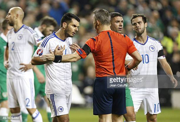 Emir Spahic of Bosnia and Herzegovina argues with referee Bjorn Kuipers of Netherlands during the UEFA EURO 2016 qualifier playoff second leg match...