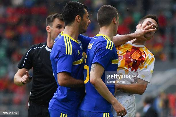 Emir Spahic of Bosnia slaps Cesar Azpilicueta of Spain during an international friendly match between Spain and Bosnia at the AFG Arena on May 29...