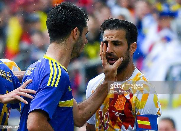 Emir Spahic of Bosnia slaps Cesc Fabregas of Spain during an international friendly match between Spain and Bosnia at the AFG Arena on May 29 2016 in...