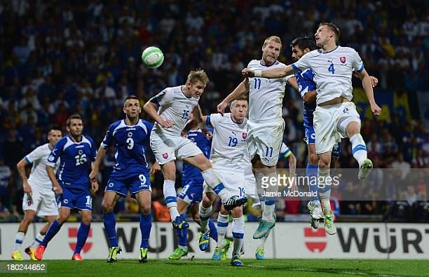 Emir Spahic of Bosnia-Herzegovina scores his goal during the FIFA 2014 World Cup Qualifying Group G match between Slovakia and Bosnia-Herzegovina at...