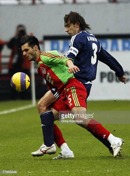 Emir Spahic of FC Lokomotiv Moscow competes for the ball with Valeri Klimov of FC Tom Tomsk during the Russian Football League Championship match...