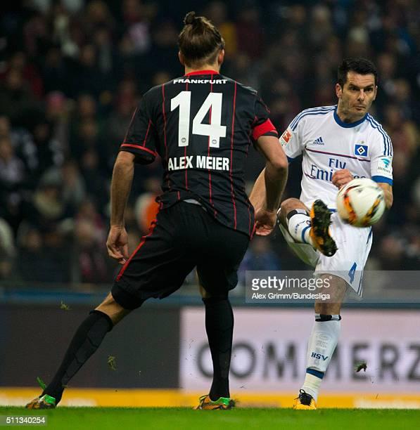 Emir Spahic of Hamburg is challenged by Alexander Meier of Frankfurt during the Bundesliga match between Eintracht Frankfurt and Hamburger SV at...