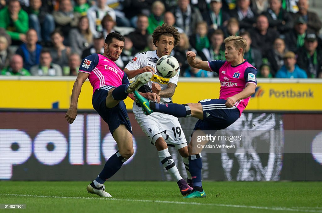 Emir Spahic of Hamburger SV, Fabian Johnson of Borussia Moenchengladbach and Lewis Holtby of Hamburger SV battle for the ball during the Bundesliga match between Borussia Moenchengladbach and Hamburger SV at Borussia-Park on October 15, 2016 in Moenchengladbach, Germany.