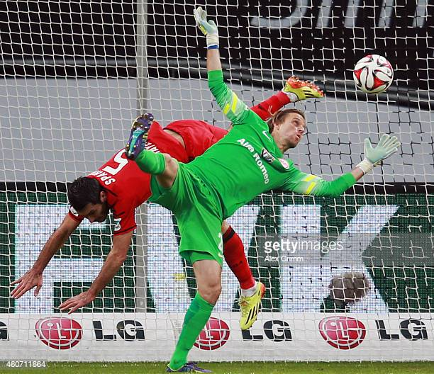 Emir Spahic of Leverkusen is challenged by goalkeeper Timo Hildebrand of Frankfurt during the Bundesliga match between Bayer 04 Leverkusen and...