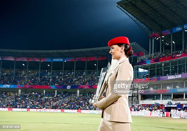 Emirates Air Hostesses carry out the World Cup Trophy during the ICC World Twenty20 India 2016 Group 2 match between New Zealand and India at the...