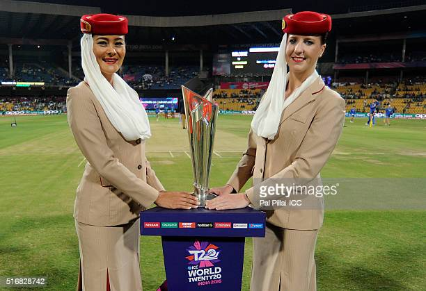 Emirates air hostesses pose with the ICC trophy before the start of the ICC World Twenty20 India 2016 match between Australia and Bangladesh at the...