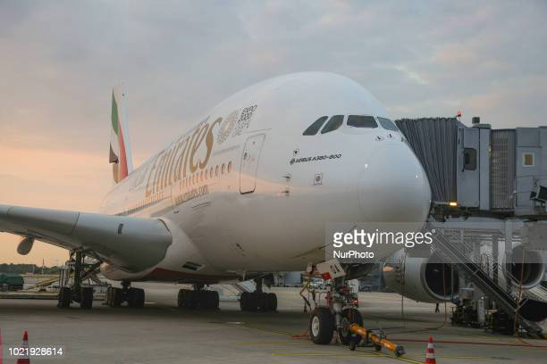 Emirates Airbus A380 docked at Dusseldorf Airport in Germany on August 21 2018 The doubledecker airplane as seen during the golden hour in Dusseldorf...
