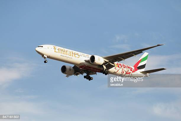 emirates aircraft on approach to land - emirates airline stock photos and pictures